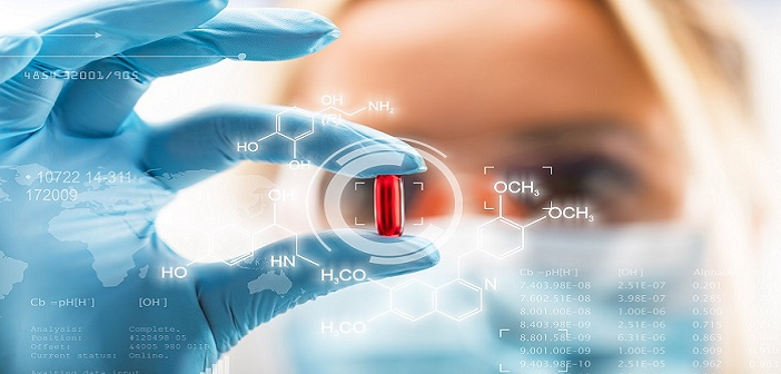 young-female-scientist-holding-red-pill-medicine-shutterstock_715861513